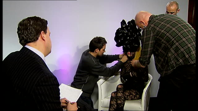 lady gaga along as greeted by itn reporter sot lady gaga seated as technicians try to find a place to attach a microphone lady gaga interview sot -... - tights stock videos & royalty-free footage