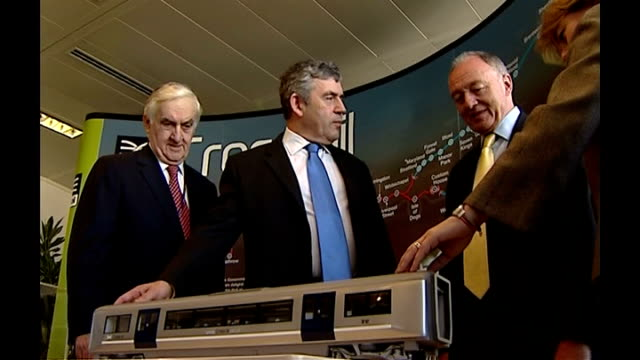 stockvideo's en b-roll-footage met london int low angle view and general view of gordon brown mp and ken livingstone looking at model of crossrail train carriage **flash photography** - ken livingstone