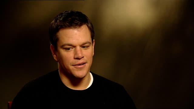 london int matt damon interview sot double decker bus with advert for 'green zone' film on side - damon green stock videos and b-roll footage