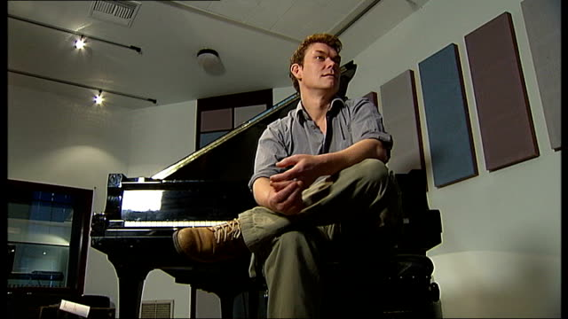 london: int mckinnon seated on piano stool next piano - stool stock videos & royalty-free footage