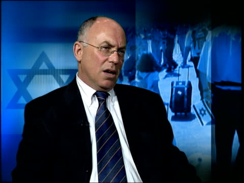 london int mike whine interview sot substantial increase since start of second intifada three years ago across europe of antisemitic violence/ it's... - western europe stock videos & royalty-free footage