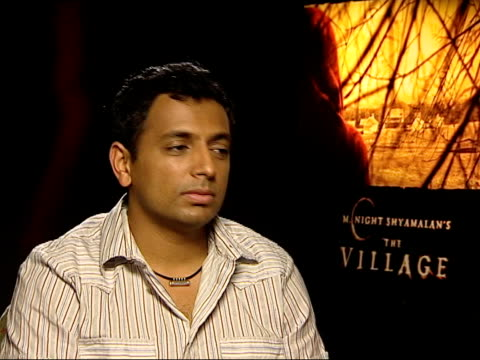 stockvideo's en b-roll-footage met london night shyamalan interviewed sot talks about the critics' reactions to his four films / thinks crtics are suspicious of all his hits - criticus