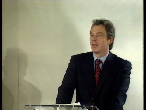 london int mss man pretending to be tony blair looking through papers at bad press coverage of labour policies shaking head int tony blair mp speech... - hands behind head stock videos & royalty-free footage