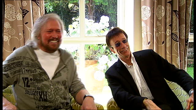 London INT **Music heard SOT** Barry Gibb and Robin Gibb interview SOT