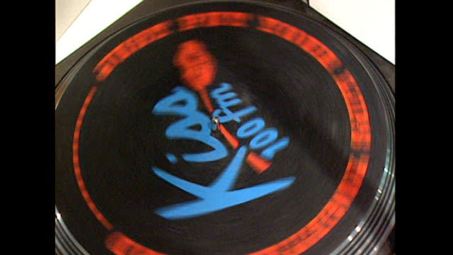 london overlay unidentified soul song** spinning record turntable with 'kiss fm' logo - soul music stock videos & royalty-free footage