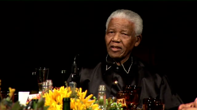 london int nelson mandela speaking at meeting sot mandela sitting with dame graca machel as gordon brown mp sarah brown bill clinton and chelsea... - 90th birthday stock videos and b-roll footage