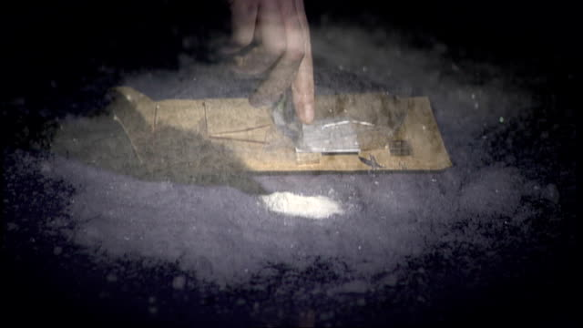 london int pile of white powder on table slow motion mephedrone drug being emptied from sachet onto table close up small heap of mephedrone on table - sachet stock videos & royalty-free footage