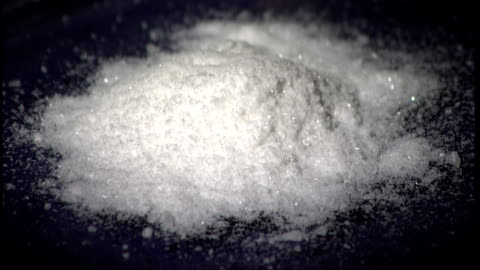 london: int pile of white powder on table slow motion mephedrone drug being emptied from sachet onto table - sachet stock videos & royalty-free footage