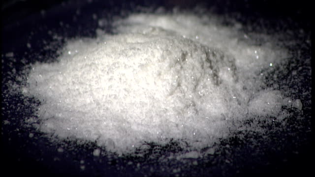 london int pile of white powder on table slow motion mephedrone drug being emptied from sachet onto table - sachet stock videos & royalty-free footage