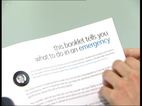 london int 'preparing for emergencies' leaflet held as pages flicked through cs text in booklet pull out pages turned text in leaflet aimed at... - flyer leaflet stock videos and b-roll footage