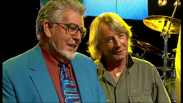 london int rolf harris and rick parfitt interview sot joke about being rolf and roll or rick and roll - guitarist stock videos & royalty-free footage