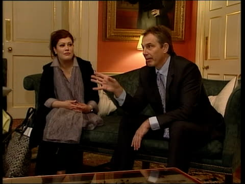 london: int seq prime minister tony blair mp sitting chatting with group of exiled iraqi women sot - file stock videos & royalty-free footage