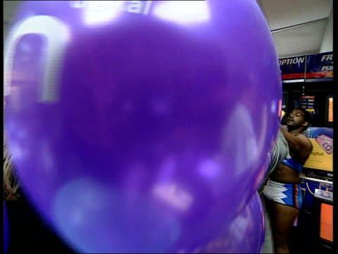 stockvideo's en b-roll-footage met london: int seq stephen grabiner posing with models and holding parcel to cameraman male model holding parcel cms bunch of blue ondigital balloons... - vanessa feltz