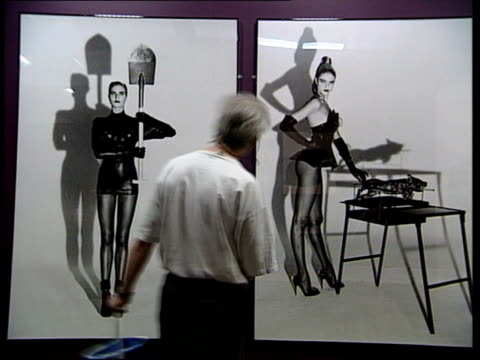 stockvideo's en b-roll-footage met london sequence helmut newton photographs displayed during exhibition duran duran song 'girls on film' - duran duran