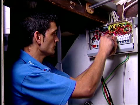 london british gas engineer taking front off fuse box cs screwdriver undoing screw on fuse box la electrical engineer checking light fitting on... - fuse box stock videos and b-roll footage