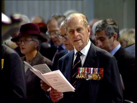 london row of dday veterans waering medals and their wives ms prince philip duke of edinburgh singing at dday memorial service in st paul's cathedral... - memorial event stock videos and b-roll footage