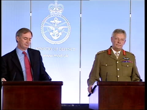smith asks what confidence this shakeup will provide solutions needed sot ministry of defence spokesman standing with hoon on podium at press... - spokesman stock videos & royalty-free footage