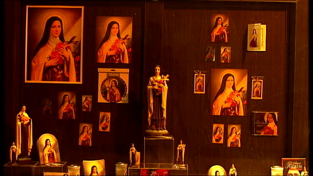 st therese religious souvenirs on display in westminster cathedral shop including close shot of statuette - westminster cathedral stock videos & royalty-free footage