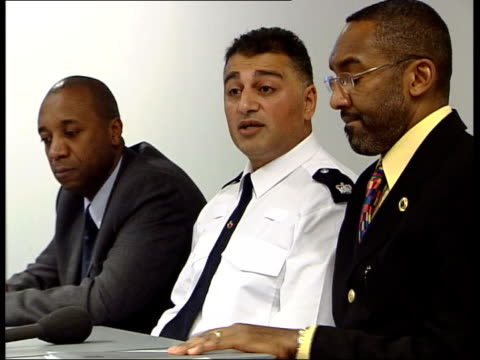 london: int superintendent ali dizaei along as speaking on mobile phone dizaei next leroy logan as taking seat in press conference pull out... - employment document stock videos & royalty-free footage