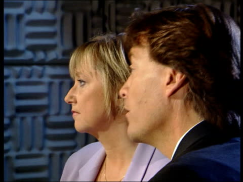england london int ms television presenters richard madeley judy finnigan in studio as filming appeal for aid for mozambique side cms lms richard... - judy finnigan stock videos and b-roll footage