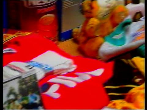 vídeos de stock, filmes e b-roll de london int tms siezed counterfeit goods on table pan rl tms counterfeit goods in clear plastic bags on shelves tilt cs label on counterfeit shirt... - polo shirt