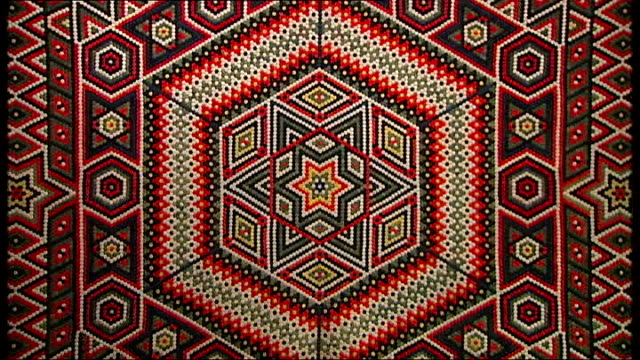 london int various close shots of quilts on display in victoria albert museum 'quilts' exhibtion patterns on quilt created by children prisoners in... - victoria and albert museum london stock videos & royalty-free footage