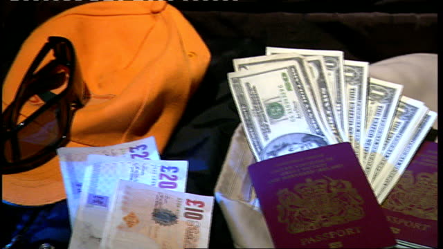 int various close shots of suitcase containing passport money sunglasses and hat kevin fulton interview sot saying his id would bluff innocent people... - checked pattern stock videos & royalty-free footage