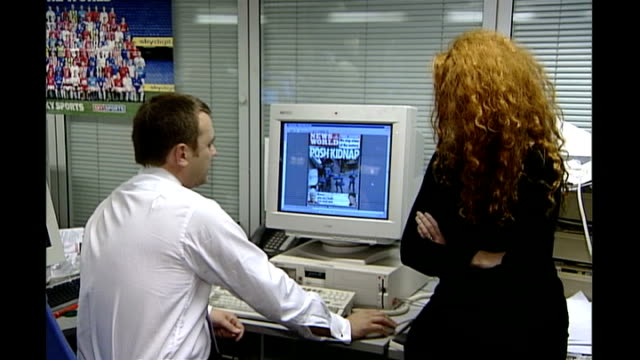 int various of andy coulson working at computer screen in news of the world newsroom - news of the world stock videos & royalty-free footage