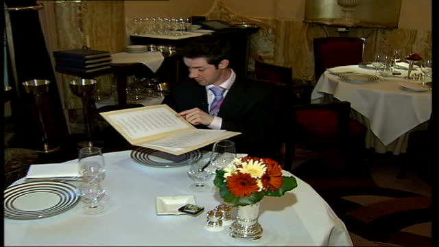 london is second most expensive city to live in; itn england: london: int i/c inside claridges hotel i/c at restaurant table menu showing difference... - claridge's stock videos & royalty-free footage