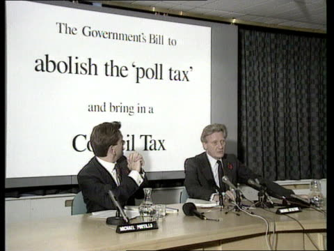 London ITN LIB / TX 300491 MS Michael Heseltine with Michael Portillo seated at pkf with banner behind 'The Government's Bill to Abolish the Poll...
