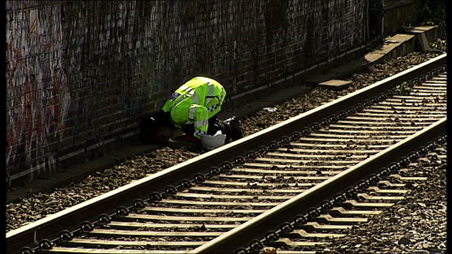 stockvideo's en b-roll-footage met london kentish town exercise *** various shots police officers with police sniffer dogs searching railway tracks for suspect explosive device back... - kentish town