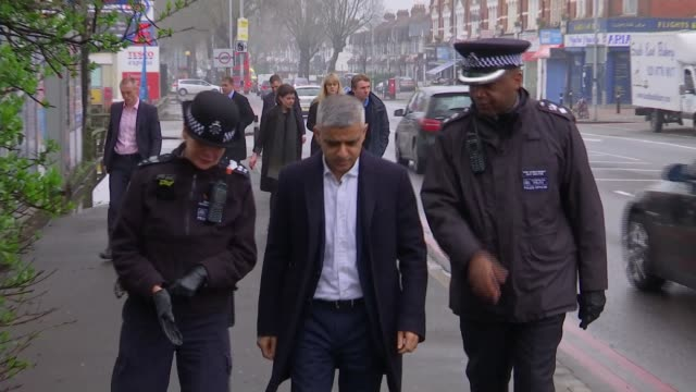metropolitan police move to raid one of london's most notorious gangs croydon sadiq khan along street with police officers as part of weapons sweep - sadiq khan stock videos and b-roll footage