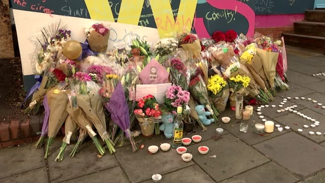 Sajid Javid promises £17 million for early intervention youth fund ENGLAND London Tulse Hill EXT Memorial wall and floral tributes for John Ogunjobi...