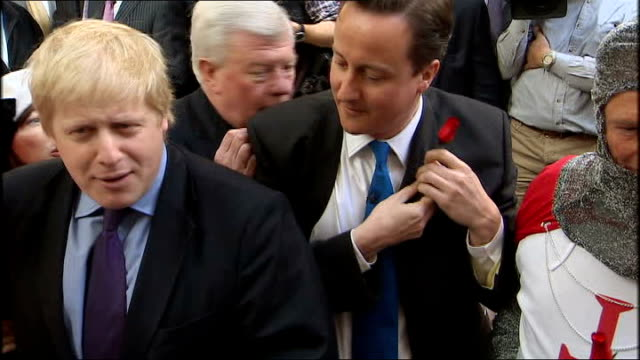 london leadenhall market photography *** david cameron mp and boris johnson at st george's day celebration as cameron puts red rose in buttonhole... - boutonniere stock videos and b-roll footage