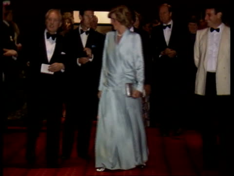 stockvideo's en b-roll-footage met england london leicester sq empire theatre ms prince and princess of wales walk towards in foyer cs steven spielberg pull out as diana chatting to... - steven spielberg