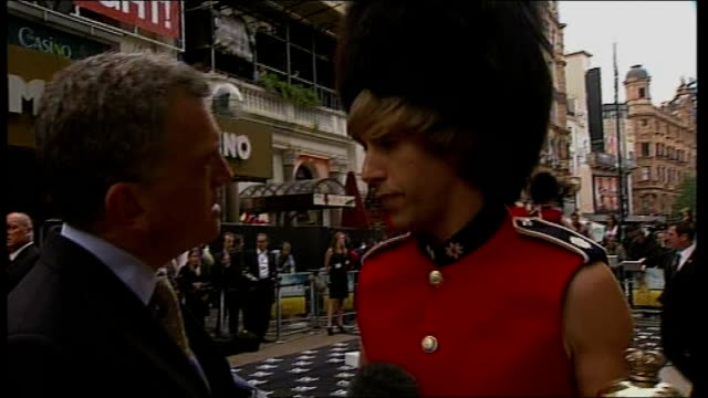 vídeos de stock, filmes e b-roll de london leicester square photography *** sacha baron cohen interviewed in role of 'bruno' character sot on what he is wearing / on gordon brown... - short curto