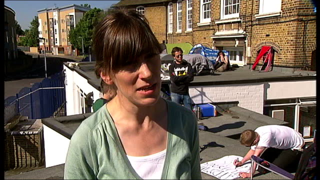 london lewisham ext various of parents protesting on school building roof about closure of lewisham bridge primary school eleanor davies interview... - boarding school stock videos & royalty-free footage
