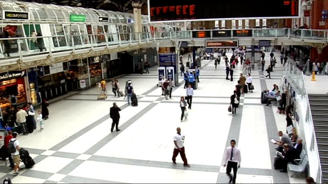 liverpool street station: int rail commuters through ticket barriers and milling about concourse electronic sign giving information about 'industrial... - east anglia stock videos & royalty-free footage