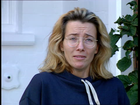 london lms emma thompson out of home stands on doorstep cms emma thompson speaking press sot buy one of the newspapers they're fantastically reliable... - emma thompson stock videos & royalty-free footage