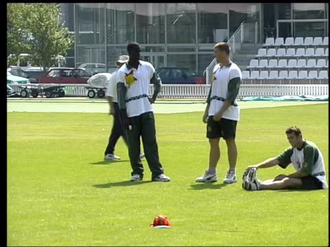 London Lords EXT Zimbabwe cricket team warming up on pitch Zimbabwe cricketer practising in nets LIB Zimbabwe cricket captain along with dogs at his...