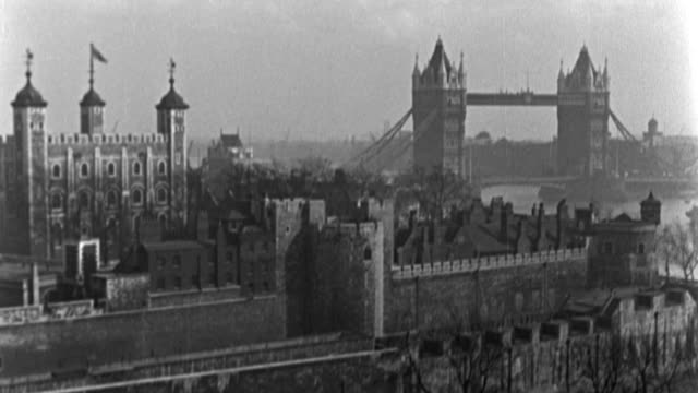 dx - london - l.s. tower of london and tower bridge - b&w. (nit. neg) - tower of london stock videos & royalty-free footage
