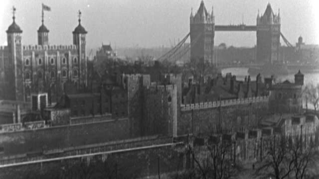 dx - london - l.s. tower of london and tower bridge - more seen of bridge then tower - b&w. (nit. neg) - tower of london stock videos & royalty-free footage