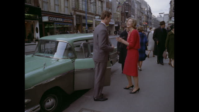 1961 - London - man waits for woman on street
