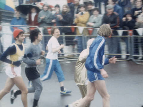 "london marathon 1981; b) england: london: runner limbers up another rubbing legs another rubs on embrocation another drinks coffee more ditto gents""... - rubbing stock videos & royalty-free footage"