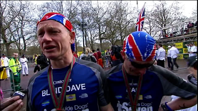 blind marathon runner dave heeley completes 7 marathons in 7 days; dave heeley and his guide malcolm carr interview sot - [heeley] we done it mate,... - atlantikinseln stock-videos und b-roll-filmmaterial