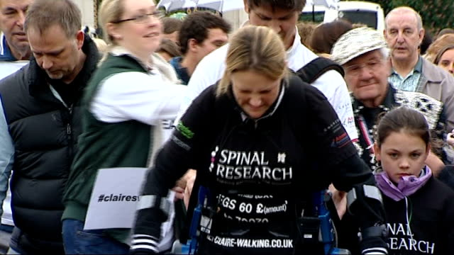 paralysed woman completes marathon course general views of lomas along marathon course with supporters gv empty biosuit held by disabled person two... - competitive sport stock videos & royalty-free footage