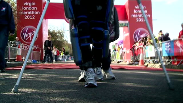 london marathon 2012: paralysed woman walks the marathon course; t22041204 london: claire lomas along at the beginning of the london marathon - disability stock videos & royalty-free footage