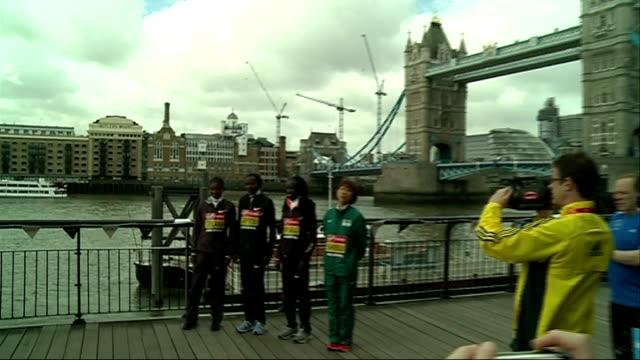 london marathon 2013 build-up: elite women runners' photocall; england: london: tower bridge: ext wlite women's marathon runners' photocall in front... - only japanese stock videos & royalty-free footage
