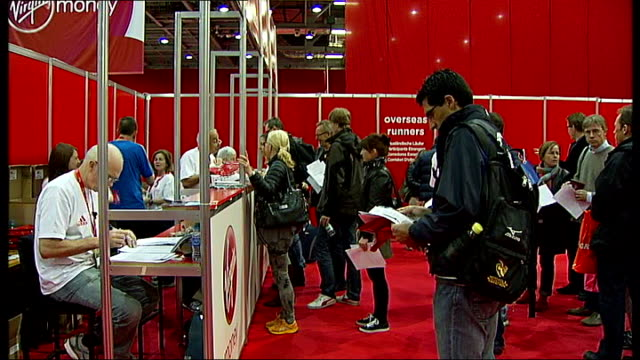 vídeos de stock, filmes e b-roll de runners register england london excel centre int people entering hall to register for the 2013 virgin london mararthon various of runners registering... - brace