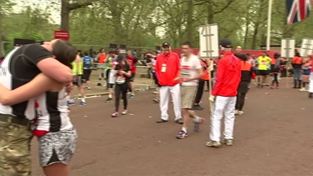 london marathon 2015 roundup / paula radcliffe racing people around at finish line pan to reporter to camera paula radcliffe interview sot knew i... - radcliffe camera stock videos and b-roll footage